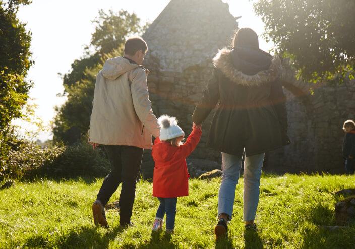 Family walking on green area